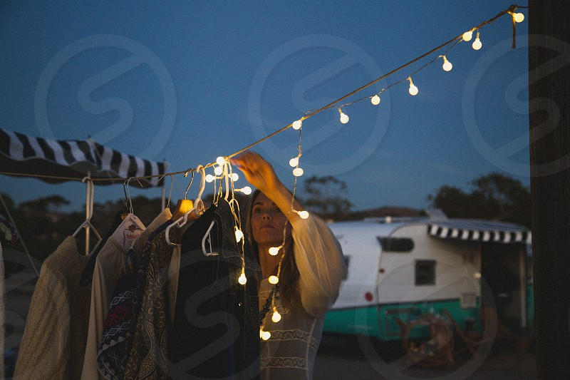 woman hanging lights on clothesline photo
