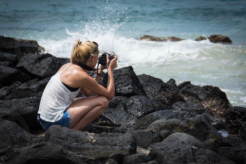 woman taking photo of ocean photo