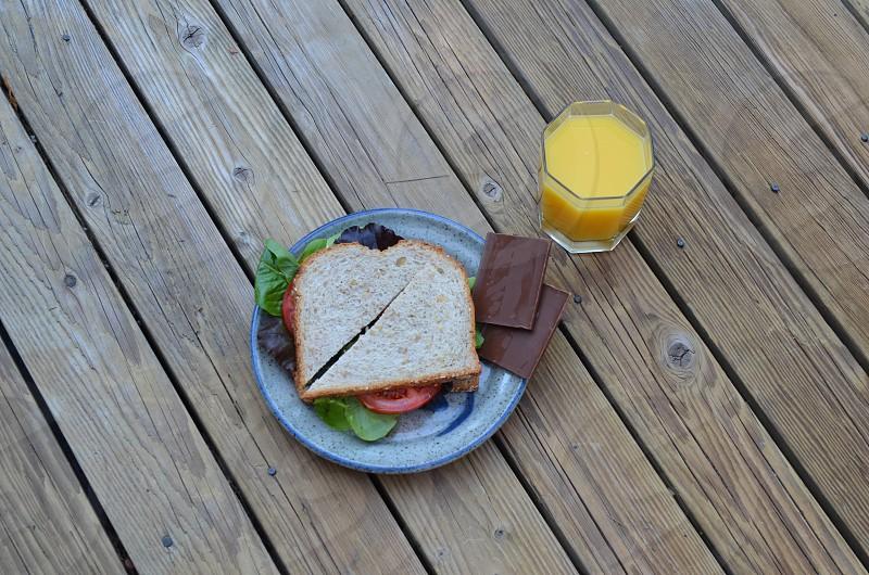Sandwich chocolate orange juice photo