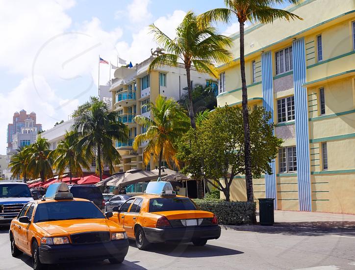 Miami Beach Ocean boulevard Art Deco district in florida USA yellow cab photo