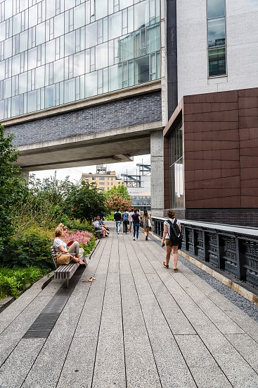 People enjoying on High Line. The High Line is an elevated linear park greenway and rail trail. It was created on a former New York Central Railroad spur on the west side of Manhattan photo
