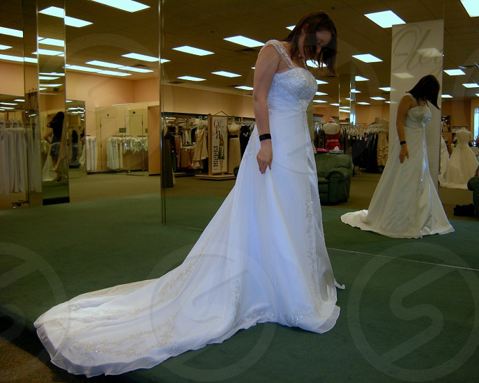 Bride to be trying on a dress photo