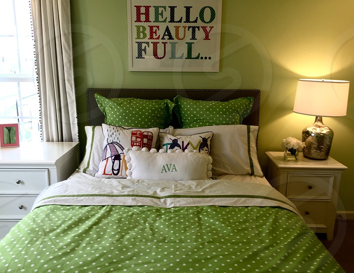 Bed pillows sheets green lamps nightstands photo