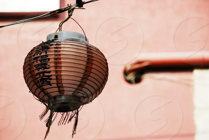 weathered red lantern in taiwan. photo