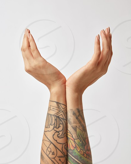 woman's open arms with a tattoo on a gray background welcome meeting photo