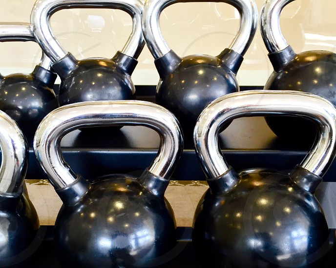 Kettle ball rack gym fit fitness strength endurance power WOD workout boot camp cardio strong lean mean photo