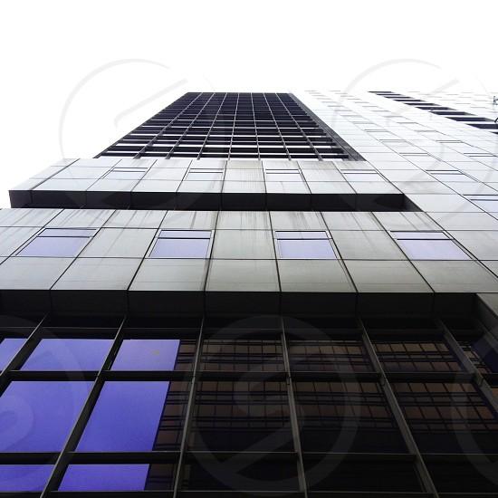 gray skyscraper with mirrors photo