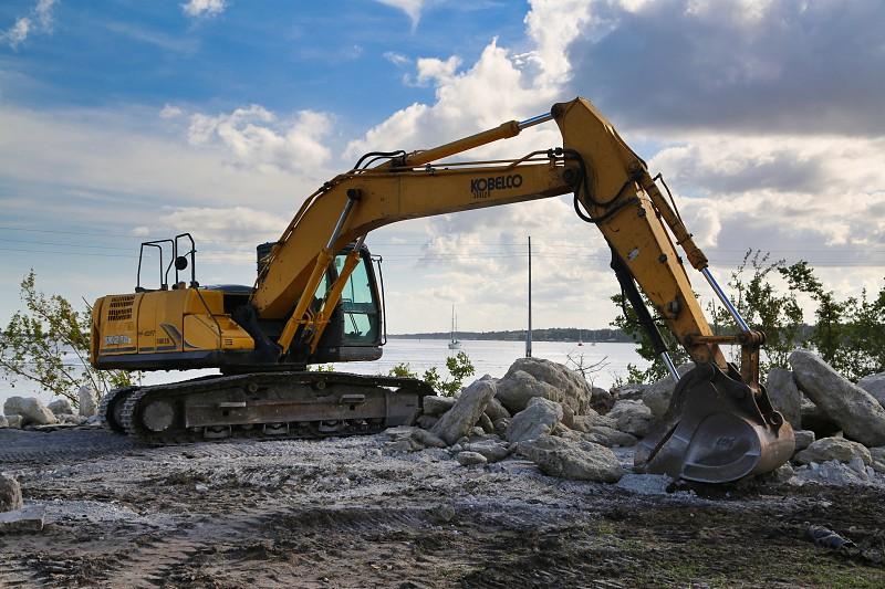 Excavator evolving the coastline photo