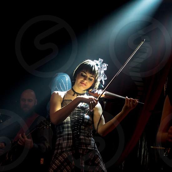 Violin; music; festival; music festival; band; song; musician; venue; light; dark; costume; female photo