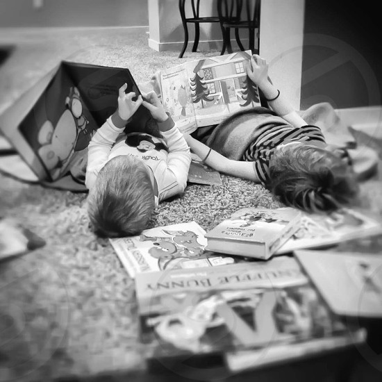 two children reading photo