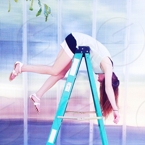 woman leaning on foldable ladder photo