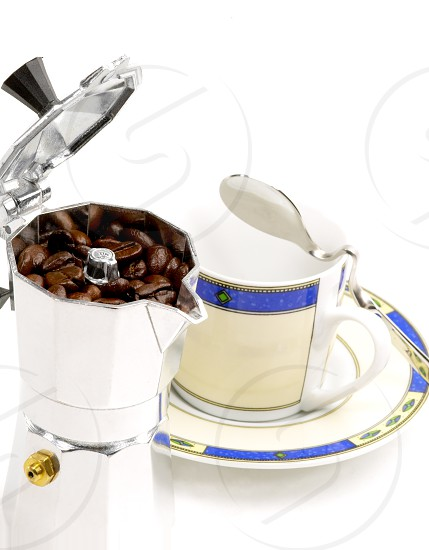 mocha coffee machine and cup on white background photo