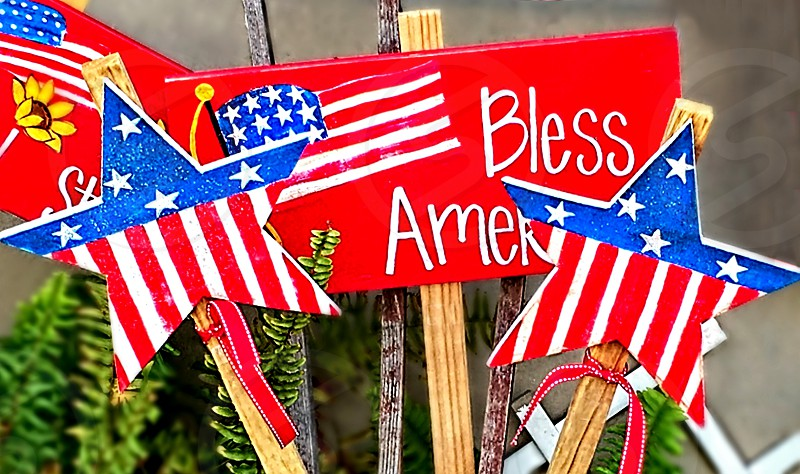 Collection of wooden patriotic yard signs for the Fourth of July photo