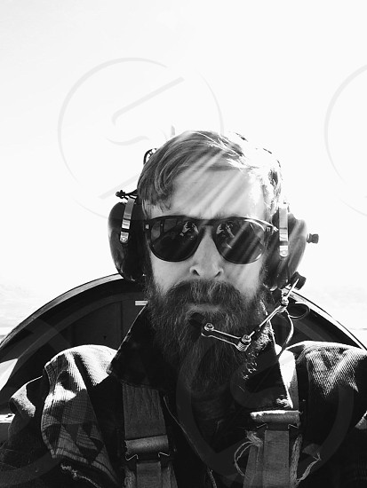 pilot on plane gray scale photography photo