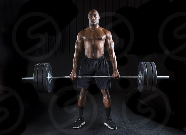 crossfit sexy fit strength heavy athletic bodybuilding healthy biceps powerful deadlift workout man muscle adult fitness gym training weight black snatch shoulder exercise weights people arm weightlifting lifestyle sport pull jerk muscular model attractive human body athlete young strong chest clean lift dumbbell health active lifting power kbs hand bodybuilder portrait beautiful photo