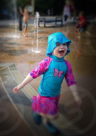 Toddler enjoying the splash pad photo
