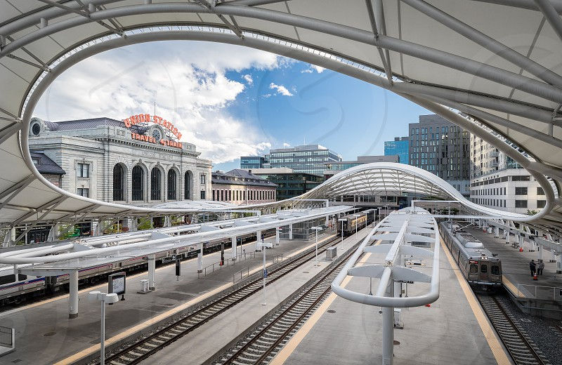 The Denver Union Station at day and sunset photo