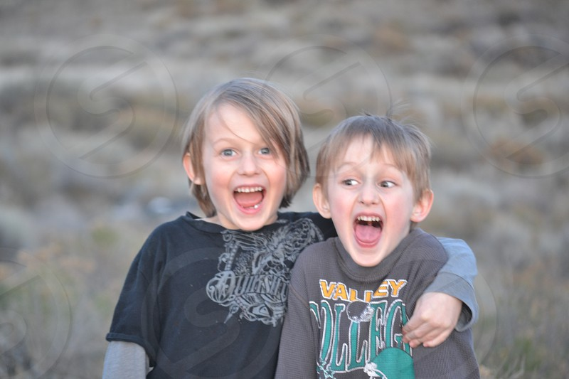 2 boys smiling photo