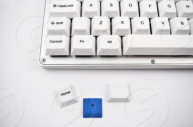 White keyboard on white background. Keyboard detail. Computer keyboard photo