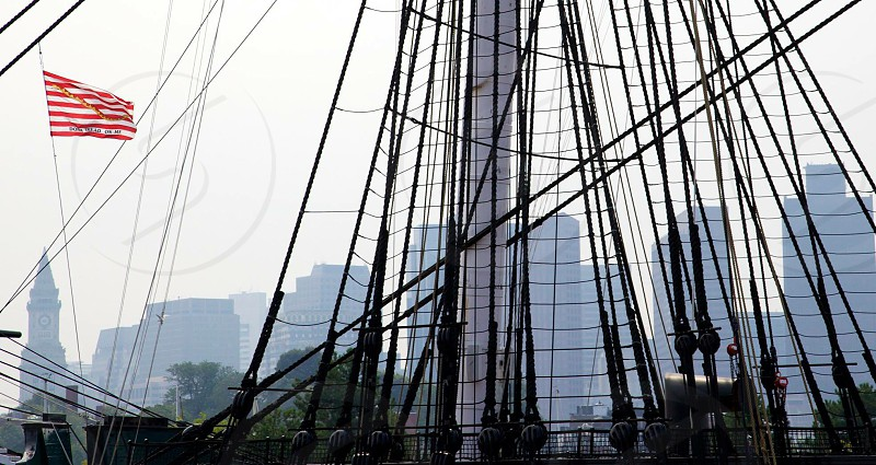 USS a Constitution BostonMass with skyline buildings  photo
