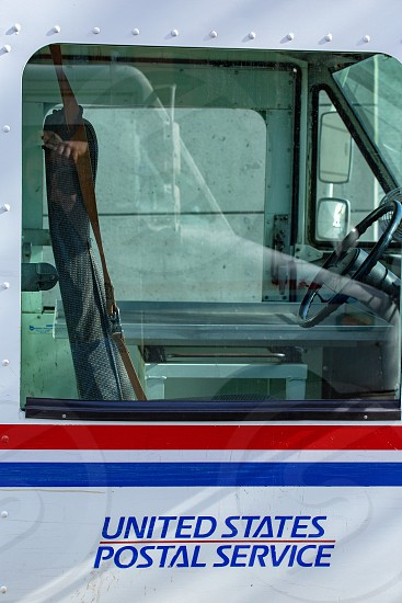 Drivers seat of a mail truck photo