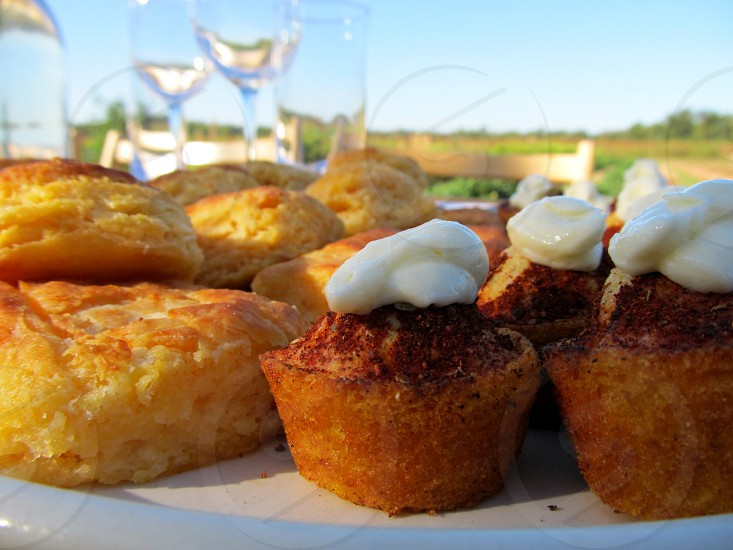Biscuits and cornbread with butter pats at farm to table dinner photo
