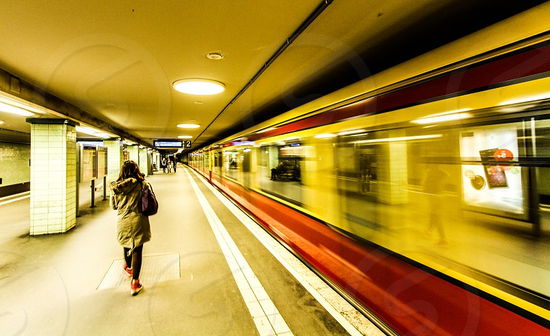 Berlin Germany East Germany subways U-Bahn tunnels night girl winter big jacket brown army green dark photo