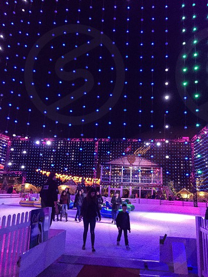 christmas lights holiday winter ice skating people family  photo
