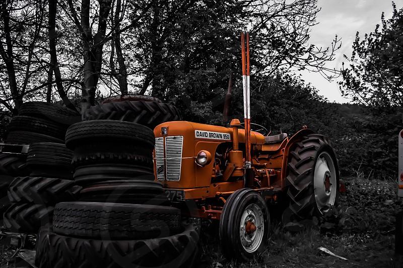 orange tractor white black tires photo