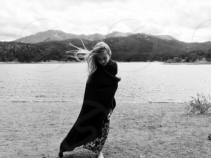 Windy mountains little girl dreamy confident reflective hopeful nature walking with blanket comforting  photo
