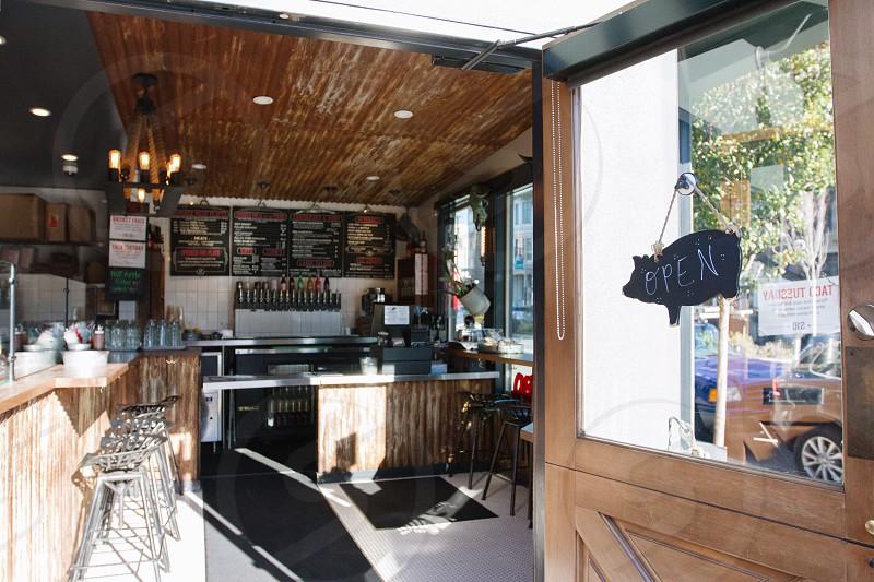brown wooden glass panel door on brown ceiling shop photo