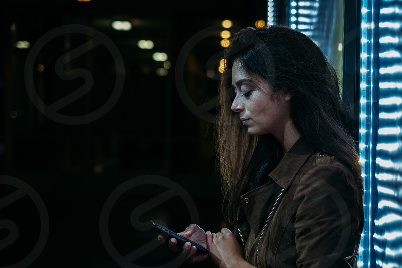 woman using mobile phone at night photo