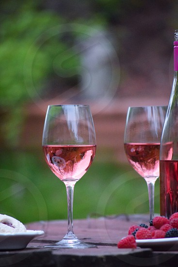 clear long stem wine glass with red wine photo