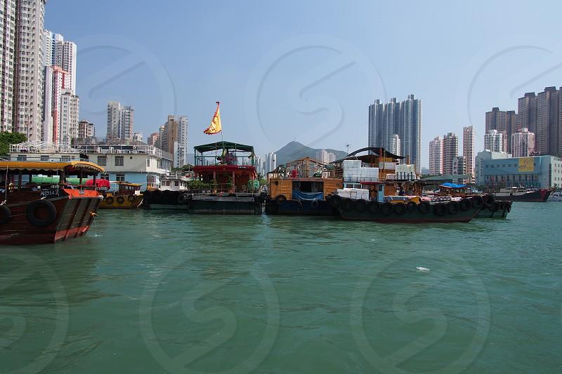 Hong Kong. China. Boats. City. Old meets new. Bay. Harbor. Fishing boats. Sky. photo