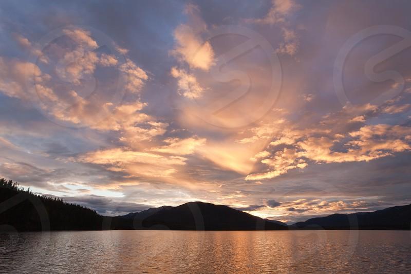 Beautiful sunset over wilderness of Big Salmon Lake Yukon Territory Canada photo