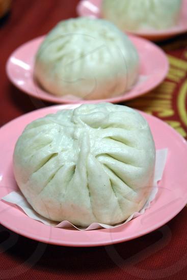 steam bun on pink round bowl photo