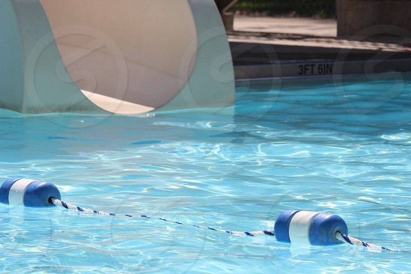 blue and white floaters on pool photo