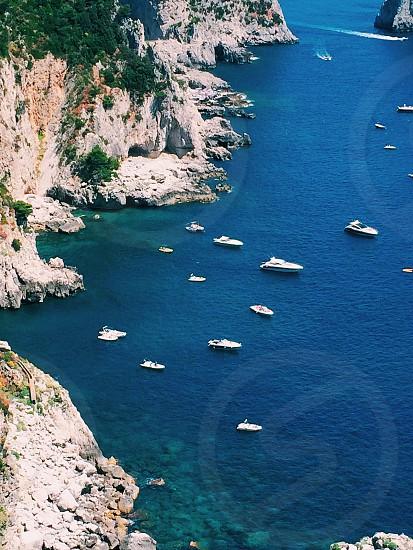 Sea ocean cliff shore boat photo