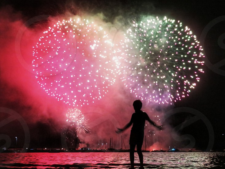 child in front of summer firework photo