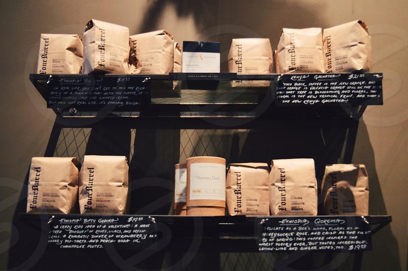 white and brown packs on black shelf photo