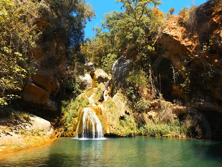 mountain lagoon lake spain spanish hidden travel waterfall vegetation photo
