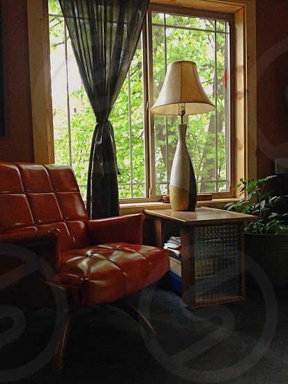 white shaded with white body table lamp on brown wooden table photo