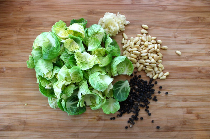 brussels sprouts pine nuts black peppercorns garlic photo