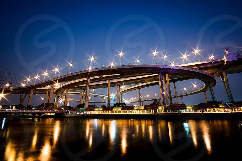 Bridge night light sky curve river shadow photo