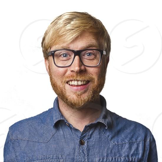 man smiling on white background.  photo