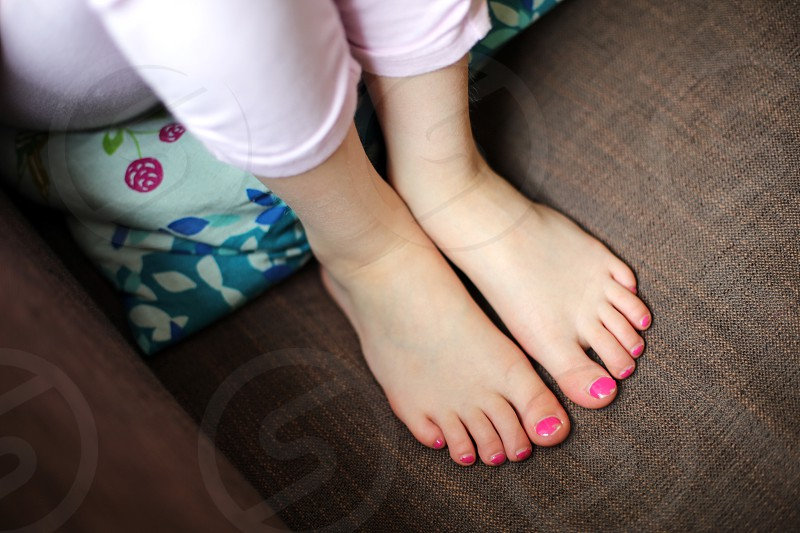 Young Girl with painted Toe Nails girl child feet nail varnish pink make-up makeup kid 5 6 7 8 9 10 pre-teen pre-teens portrait concept toes photo