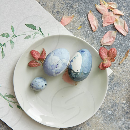 Easter place setting with easter eggs and leaves and flowers photo