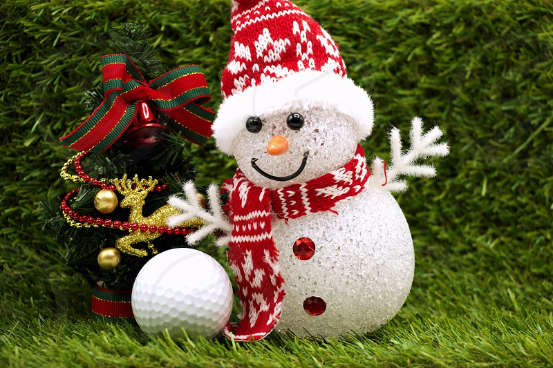 Snowman is playing with golf ball Christmas ornament photo