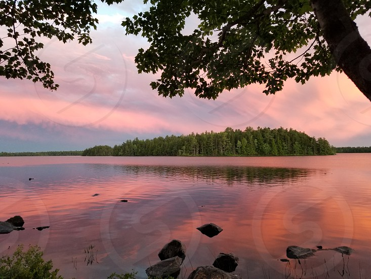 lake coral island trees reflection cloud sunsetwater summer dusk photo
