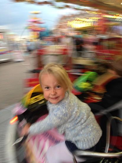 young girl having fun on a fairground ride photo